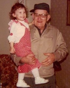 Me and my grandpa.  I think I was 3.  We are standing in the family room of the house.