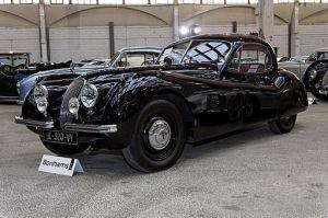 Jaguar XK120 roadster he uses in France