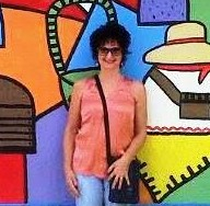 me in front of mural